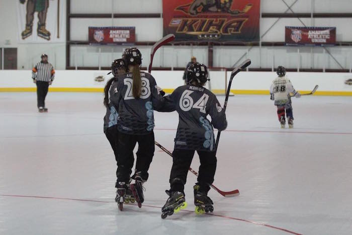 inline hockey players on the ice